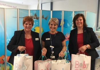 Lesley Gerrish, Branch Manager and Susan Steinlet from Nationwide Kilmarnock handing over the knitted donations to Caroline Blake, Clinical Midwife Manager Neonatal Services.
